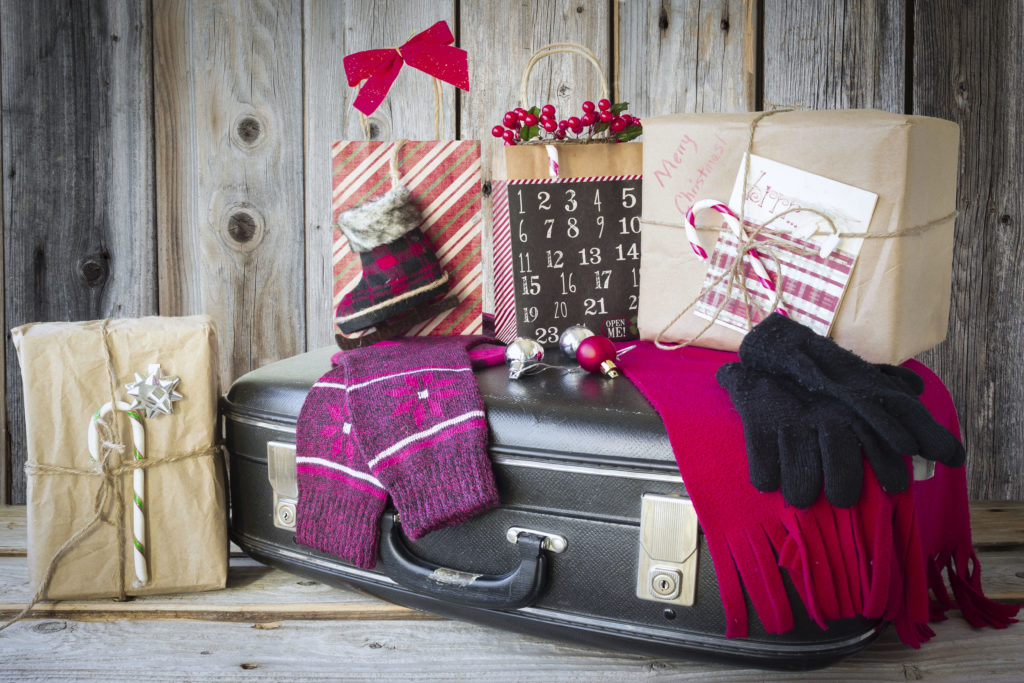 Christmas gifts on a suitcase