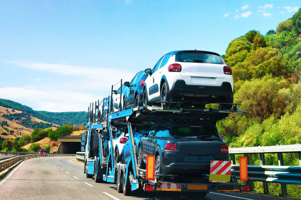 Cars on a transporter on a country road