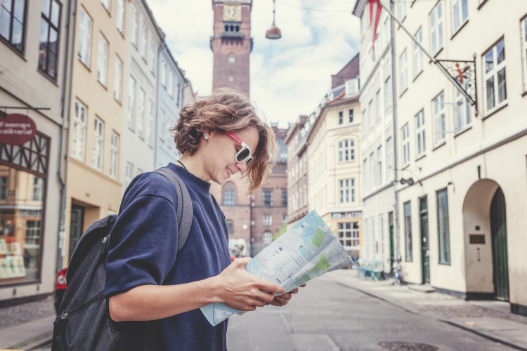 Girl reading map in European city