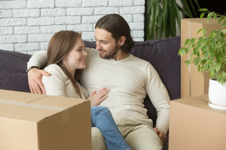 Couple on Sofa by Moving Boxes
