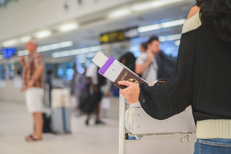 Woman in Airport Holding Passport