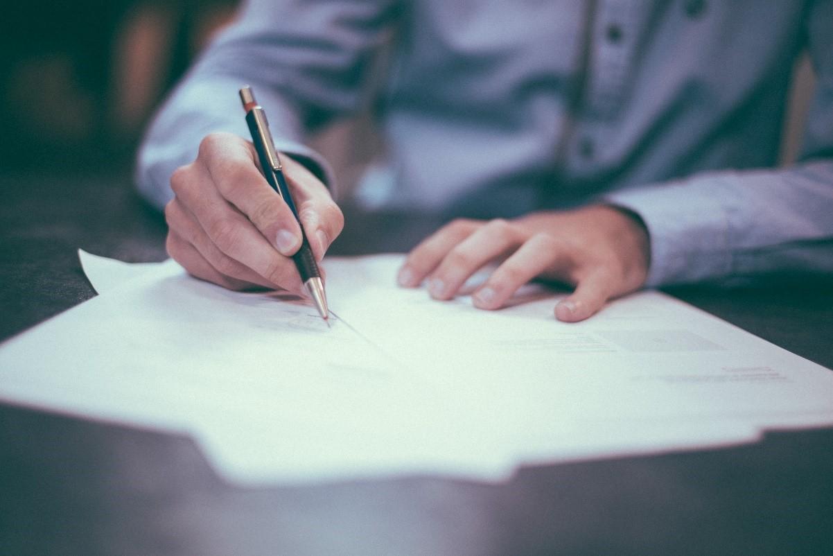 man writing insurance policy